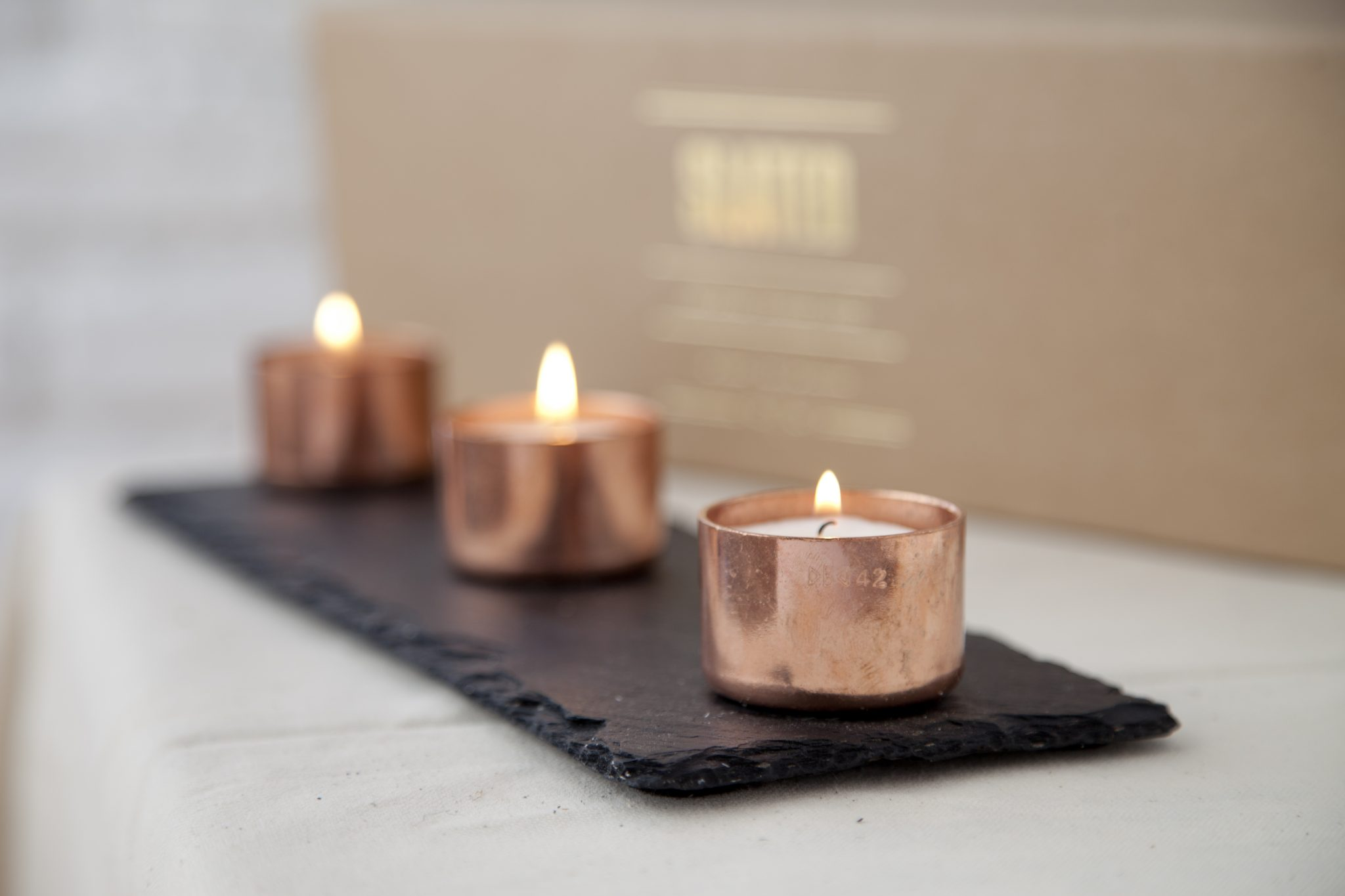 Slate and copper candle trio